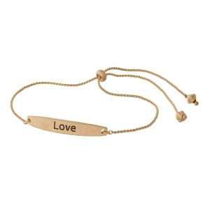 """Metal, pull-tie bracelet with a bar focal stamped with """"Love."""""""