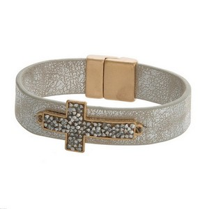 Faux leather bracelet with a chip stone cross focal and a magnetic closure.