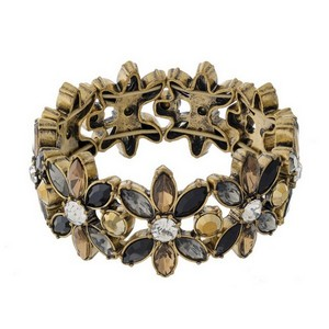 Burnished gold tone stretch bracelet with clear, black and topaz rhinestones.