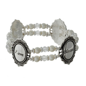 "Pearl beaded stretch bracelet with silver tone shapes, stamped with ""I am Blessed."""