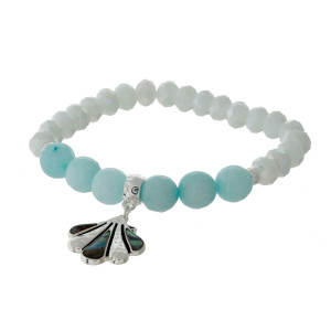 Faceted and mint green natural stone, beaded stretch bracelet with a silver tone and abalone sea life charm.