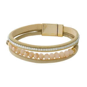 Faux leather bracelet with clear rhinestones, faceted beads and a magnetic closure.