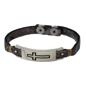 Faux leather snap bracelet with a stamped cross focal.