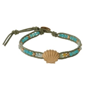 Mint beaded and faux leather bracelet with sea life accents and a button closure.