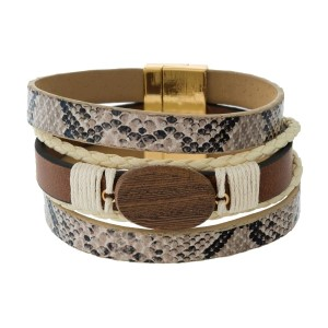 Faux leather bracelet with a wooden focal bead, an animal skin pattern and a gold tone magnetic closure.