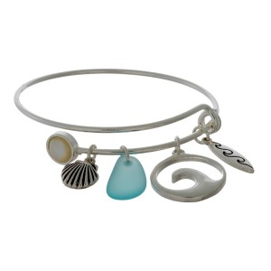 Dainty, adjustable bangle bracelet with beach themed charms.