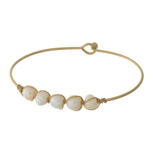 Dainty gold tone bangle bracelet with wire-wrapped, natural stones.