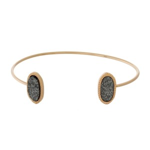 Dainty gold tone, metal cuff bracelet with faux druzy stones at the openings.