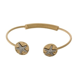 Metal, hinge bangle bracelet with two tone starfish.