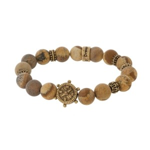 Natural stone beaded stretch bracelet with a gold tone anchor and compass accent.