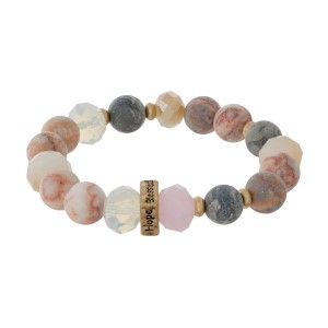 """Natural stone and beaded stretch bracelet with a gold tone bead stamped with """"Faith, Hope, Love, Blessed."""""""