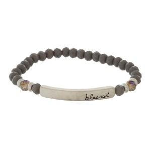 """Beaded stretch bracelet with a bar focal, stamped with """"blessed."""""""