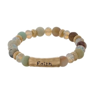 "Natural stone stretch bracelet with a bar focal, stamped with ""Faith"" and gold tone accents."