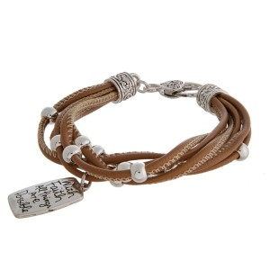 Faux leather bracelet with silver tone beads, a lobster clasp, and a stamped charm.
