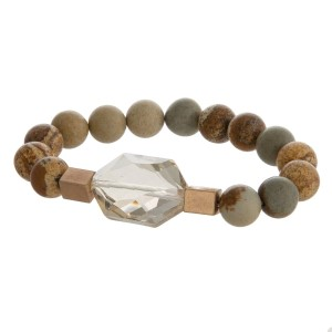 Natural stone beaded stretch bracelet with gold tone accents and a faceted stone.