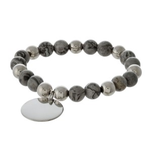 Natural stone stretch bracelet with gold circle charm.