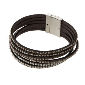 Faux leather bracelet with rhinestone details and a magnetic closure.