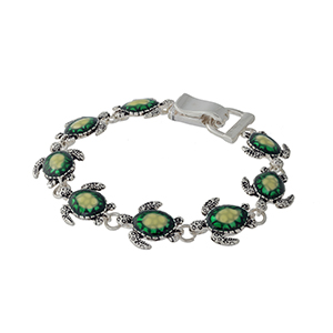 "7 1/2"" around swimming turtles bracelet with yellow and green accents."