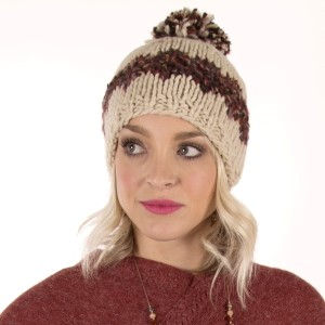 Ivory and brown knit beanie hat with a pom pom on the top. 100% acrylic.