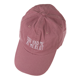 "Mauve hat with a velcro adjustable back, embroidered with ""You had me at Merlot."""