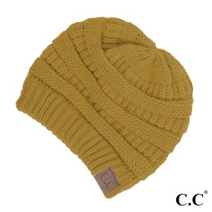 "The original C.C beanie style in mustard. 100% acrylic. Measures 9.5"" in diameter and 8"" in length."