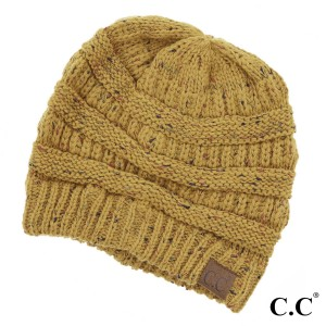 Cable knit, confetti print C.C beanie in mustard. 100% acrylic.