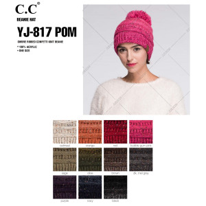 Cable knit, confetti print C.C beanie with pom pom, in dark melange gray. 100% acrylic.