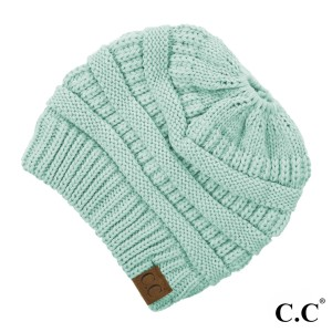 Messy-bun, C.C beanie in mint. 100% acrylic.