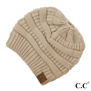 Messy-bun, C.C beanie in new beige. 100% acrylic.