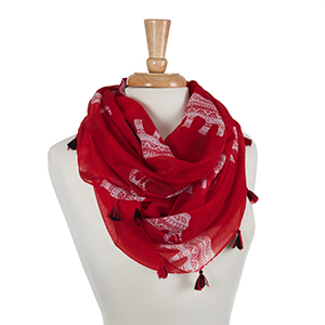 """Lightweight red scarf displaying white ethnic elephants and black tribal designs with mini tassels. 100% Polyester. Approximately 24"""" x 72""""."""