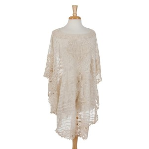 Ivory crochet poncho top that can we worn as a swimsuit cover up as well. 100% cotton. One size fits most.