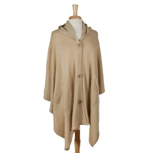 Beige hooded poncho with a button front. 100% acrylic. One size fits most.