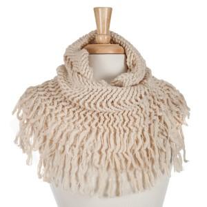 Beige knit tube scarf with fringe. 100% acrylic.