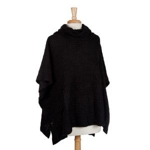 Black short sleeve, turtle neck poncho top with a cable knit pattern. 100% acrylic. One size fits most.