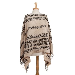 Beige and black knit cape with a tribal pattern. 100% viscose. One size fits most.