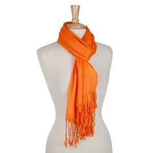Orange open scarf with fringe details. 100% viscose.