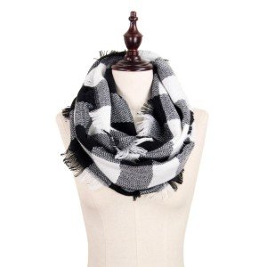 """Black and white buffalo plaid infinity scarf with frayed edges. 100% acrylic.  Measures 18"""" x 36"""" in size."""