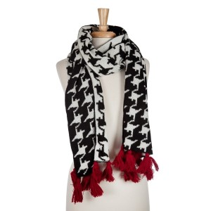 Black and white houndstooth open scarf with red tassels. 100% acrylic.
