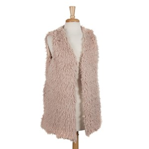 Beige faux fur vest with pockets and a hidden hook closure. 100% polyester. One size fits most.