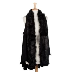 Black vest with a faux fur trim. 100% acrylic. One size fits most.