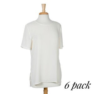 Lightweight short sleeve ivory top with a scoop hem and a relaxed fit. 100% polyester. Sold in packs of six - two smalls, two mediums, and two larges.