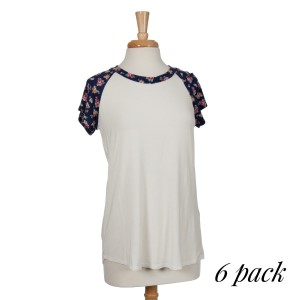 """Ivory short sleeve """"baseball top"""" with navy blue sleeves and a floral pattern. 95% rayon and 5% spandex. Sold in packs of six - two smalls, two mediums, and two larges."""