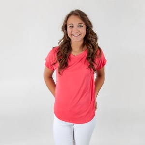 Coral short sleeve top with a relaxed fit and a scoop bottom. 95% rayon and 5% spandex. Sold in packs of six - two smalls, two mediums, two larges.