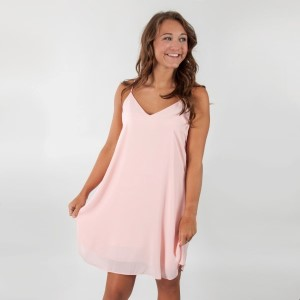 Blush pink racerback dress with spaghetti straps. Fully lined. 100% polyester. Sold in packs of six - two smalls, two mediums, and two larges.