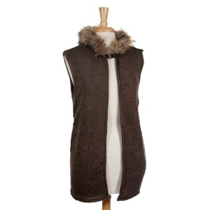 Olive green vest with a raccoon fur trimmed hood, a front hook closure and pockets. 68% acrylic, 15% polyester, 17% spandex. One size fits most.