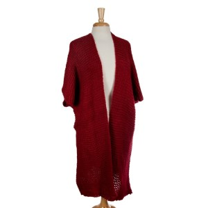 Crimson knit duster with short sleeves and a loose fit. 100% acrylic. One size fits most.