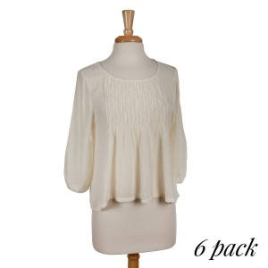 Ivory colored top with front pleats and 3/4 length sleeves. Fits true to size. 100% rayon. Sold in packs of six - two smalls, two mediums, and two larges.
