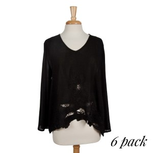 Black long sleeve top with floral embroidery and cut outs. Relaxed fit. 100% rayon. Sold in packs of six - two smalls, two mediums, two larges.