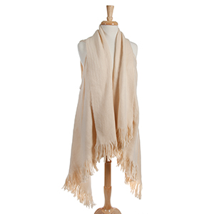 Ivory, long vest with fringe details on the outer edges. 100% acrylic. One size fits most.