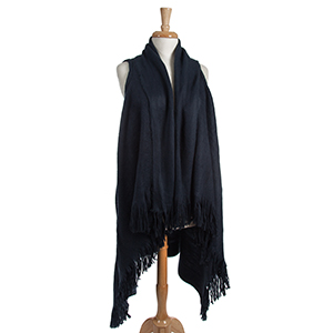 Navy blue, long vest with fringe details on the outer edges. 100% acrylic. One size fits most.